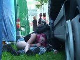 Guy And His Girfriend Are Having Public Sex Between Trucks On Concert