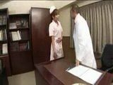 Japanese Nurse Taking Care That a Doctor Is Relaxed During A Break In His Office